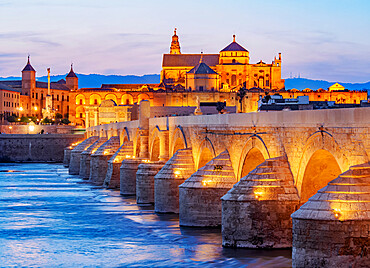 View over Roman Bridge of Cordoba and Guadalquivir River towards the Mosque Cathedral, dusk, Cordoba, Andalusia, Spain