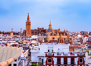 View from Metropol Parasol towards The Church of the Divine Savior and The Cathedral at sunset, Seville, Andalusia, Spain