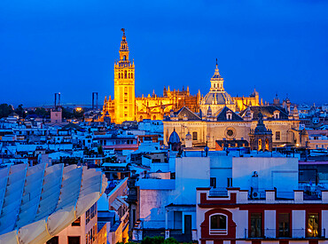 View from Metropol Parasol towards The Church of the Divine Savior and The Cathedral at dusk, Seville, Andalusia, Spain