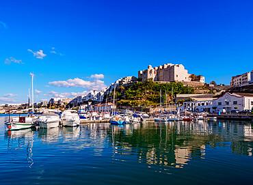 Boats in port and Saint Francis Monastery, Mahon or Mao, Menorca or Minorca, Balearic Islands, Spain