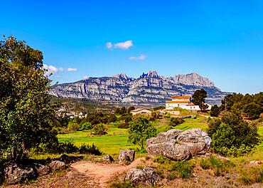View towards the Montserrat, a multi-peaked mountain range near Barcelona, Catalonia, Spain