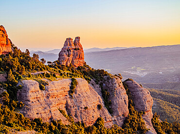 La Castellassa de Can Torras and La Mola at sunrise, Sant Llorenc del Munt Natural Park, Matadepera, Catalonia, Spain