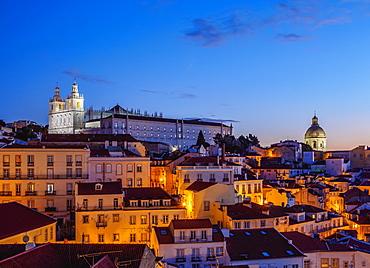Miradouro das Portas do Sol, twilight view over Alfama Neighbourhood towards the Sao Vicente de Fora Monastery, Lisbon, Portugal, Europe