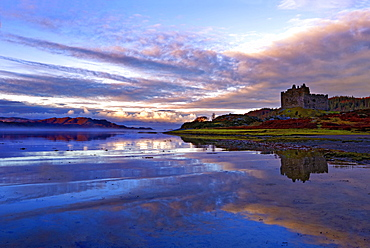 Early morning view of Castle Tioram and Loch Moidart as dawn breaks in a warm colorful sky to form attractive reflections, Highlands, Scotland, United Kingdom, Europe - 1246-7