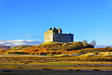 Castle Tioram on the coastal island Eilean Tioram where River Shiel and Loch Moidart meet, at low tide on a sunny winter morning, Highlands, Scotland, United Kingdom, Europe - 1246-8