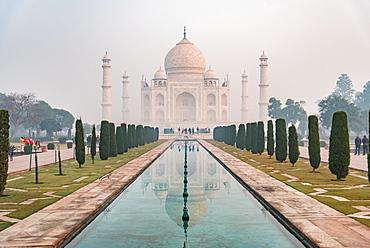 Taj Mahal reflections on a misty morning, UNESCO World Heritage Site, Agra, Uttar Pradesh, India, Asia