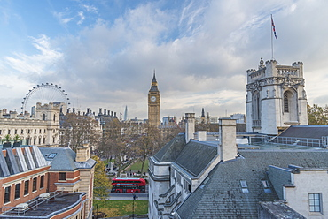 A London bus navigating Westminster with a beautiful blue sky above, London, England, United Kingdom, Europe