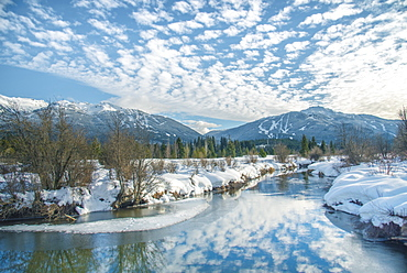 White clouds reflect over the River of Golden Dreams in Whistler, British Columbia, Canada, North America