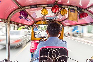 Riding in the back of a Tuk Tuk in Bangkok, Thailand, Southeast Asia, Asia