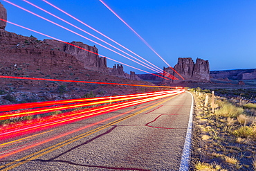 Car lights, Arches National Park, Moab, Utah, United States of America, North America