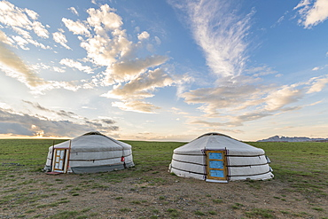 Mongolian nomadic traditional gers and clouds in the sky, Middle Gobi province, Mongolia, Central Asia, Asia