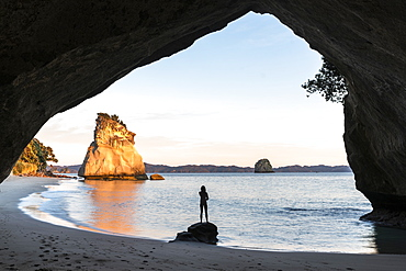 Woman's silhouette at Cathedral Cove, Hahei, Waikato region, North Island, New Zealand, Pacific