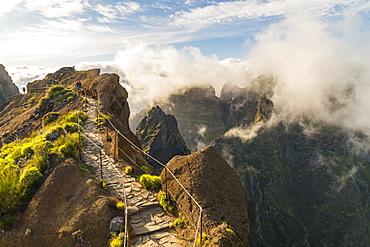Hikers walking on Vereda do Areeiro, the trail that links Pico Ruivo to Pico do Arieiro, Funchal, Madeira, Portugal, Atlantic, Europe