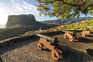 Historical cannons at Faial fortress with the village in the background, Faial, Santana municipality, Madeira, Portugal, Atlantic, Europe