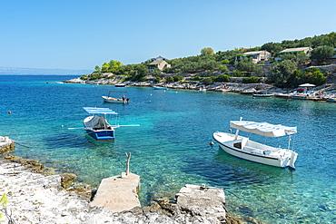 Boats at the little pier of Tankaraca cove in summer, Vela Luka, Korcula island, Dubrovnik-Neretva county, Croatia, Europe