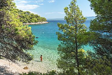 Woman bathing in the sea at Draceva beach, Murvica, Bol, Brac island, Split-Dalmatia county, Croatia, Europe