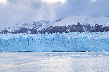 Southern terminus of Perito Moreno glacier under a moody sky, Los Glaciares National Park, UNESCO World Heritage Site, Santa Cruz, Argentina, South America