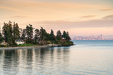 Bainbridge Island at sunset, with Seattle cityscape in the background, Seattle, Kitsap county, Washington State, United States of America, North America