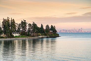 Bainbridge Island at sunset, with Seattle cityscape in the background, Seattle, Kitsap county, Washington State, United States of America, North America