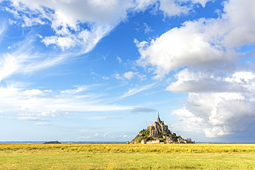 Clouds in the sky and grass in the foreground, Mont-Saint-Michel, UNESCO World Heritage Site, Normandy, France, Europe