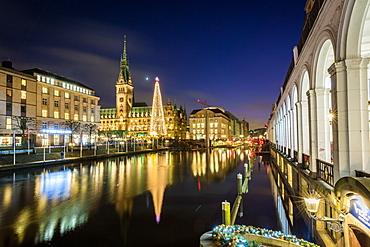 Reflection of Hamburg's Town Hall (Rathaus) and Christmas Market at blue hour, Hamburg, Germany, Europe