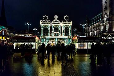 The entrance to Hamburg's Rathaus Christmas Market (Weihnachtsmarkt Rathausmarkt) at night, Hamburg, Germany, Europe