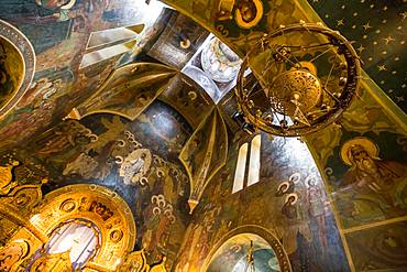 The painted ceiling of an ornate church in Bucharest, Romania, Europe
