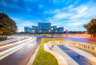 Car light trails at blue hour in front of the huge Palace of Parliament (Palatul Parlamentului), Bucharest, Romania, Europe