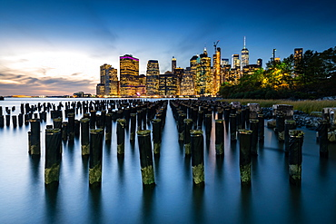 Long exposure of the lights of Lower Manhattan during the evening blue hour as seen from Brooklyn Bridge Park, New York, United States of America, North America