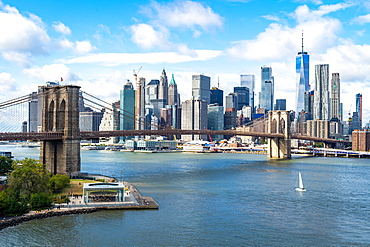The view over the East River towards the Brooklyn Bridge and Lower Manhattan, New York, United States of America, North America