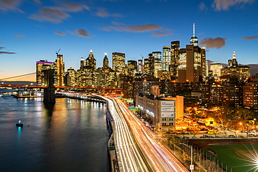 The lights of Lower Manhattan at dusk viewed from the Manhattan Bridge, New York, United States of America, North America