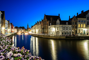 An evening blue hour scene along the canals of Bruges, Belgium, Europe