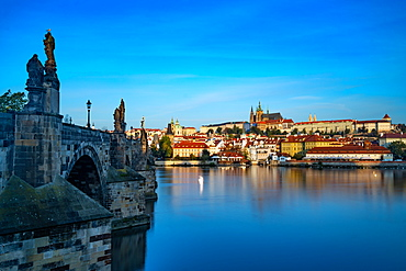 The early morning sun lights up St. Vitus Cathedral and Prague Castle, UNESCO World Heritage Site, Prague, Czech Republic, Europe