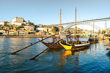 Boats of the Port Bodegas on the Douro River looking towards the Ribeira district of Porto, Portugal, Europe