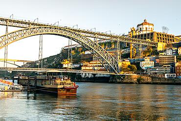 The Dom Luis I Bridge at sunset looking towards the Monastery of Serra do Pilar, UNESCO World Heritage Site, Porto, Portugal, Europe