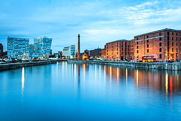 Looking along Canning Dock, adjacent to Albert Dock, towards the Pump House Pub during the evening twilight (blue hour), Liverpool, Merseyside, England, United Kingdom, Europe