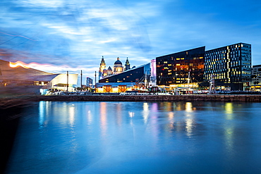 Looking over Canning Dock towards the Museum of Liverpool and Liver Building during the evening twilight (blue hour), Liverpool, Merseyside, England, United Kingdom, Europe