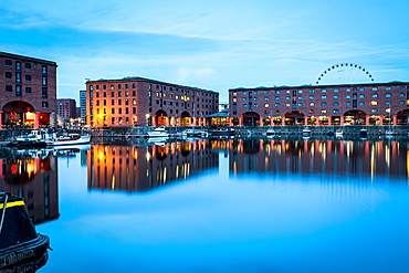 The Wheel of Liverpool seen behind the Albert Dock on the River Mersey waterfront, UNESCO World Heritage Site, during the evening twilight (blue hour), Liverpool, Merseyside, England, United Kingdom, Europe