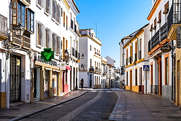 The white and yellow buildings of a typical Andalusian street in Cordoba, Andalusia, Spain, Europe
