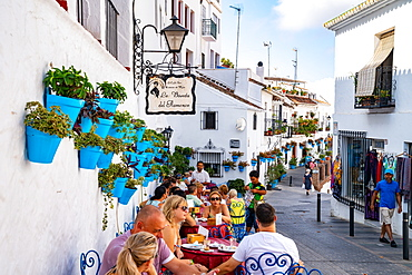 Blue plant pots on the white walls of La Boveda del Flamenco cafe bar, Plaza de la Constitucion, Mijas Pueblo, Andalusia, Spain, Europe