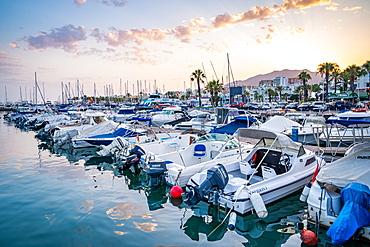 Boats at sunset at Benalmadena Puerto Marina between the Costa Del Sol beach resorts of Benalmadena and Torremolinos, Andalusia, Spain, Europe
