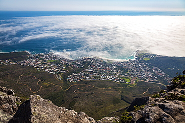 The view from Table Mountain over Camps Bay covered in low cloud, Cape Town, South Africa, Africa
