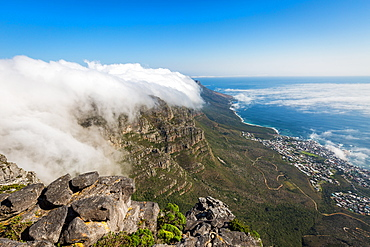 Table Mountain covered in a tablecloth of orographic clouds, Camps Bay below covered in low cloud, Cape Town, South Africa, Africa