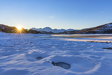 Campotosto Lake in winter at sunrise, Gran Sasso National Park, Abruzzo, Italy, Europe