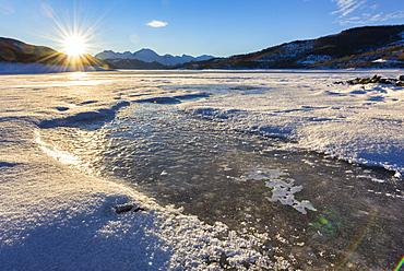 Lake Campotosto at sunrise in winter, Gran Sasso National Park, Abruzzo, Italy, Europe