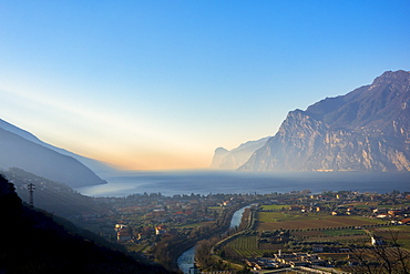 Riva del Garda at sunrise in winter, Lake Garda, Trentino, Dolomites, Italy, Europe