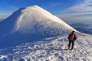 Hiker near the summit in winter, Mount Acuto, Apennines, Umbria, Italy, Europe