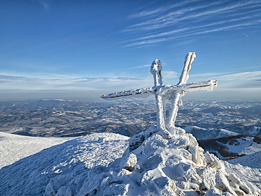 Summit cross of Mount Acuto in winter, Apennines, Umbria, Italy, Europe