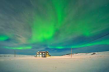 Europe, Norway, Finnmark, Kongsfjord, Veidnes, Blue house and aurora borealis
