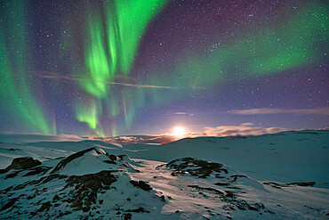 Europe, Norway, Finnmark, Aurora over the mountains